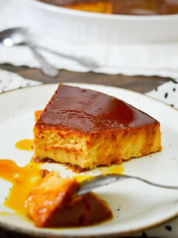 sliced pumpkin flan on a white plate
