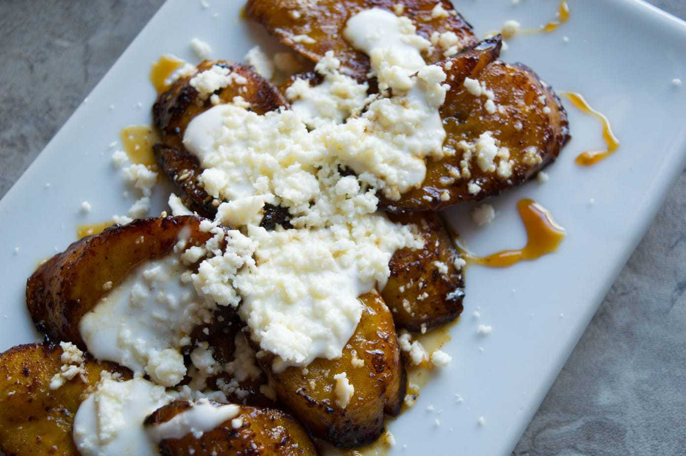 Mexican sweet orange honey plantains with cream and cheese.
