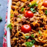 Rustic Puerto Rican Beef and Sausage Pasta Bake in a pan garnished with cilantro