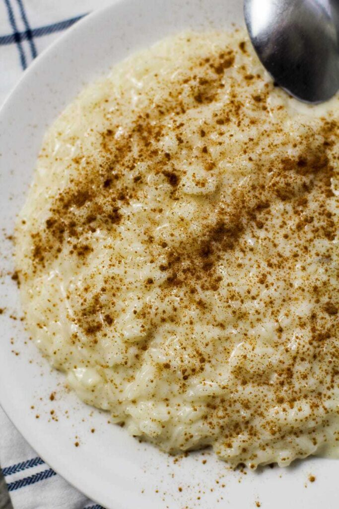 rice pudding with cinnamon on a white plate