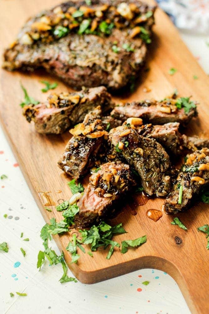 Garlic Cuban Steak on cutting board