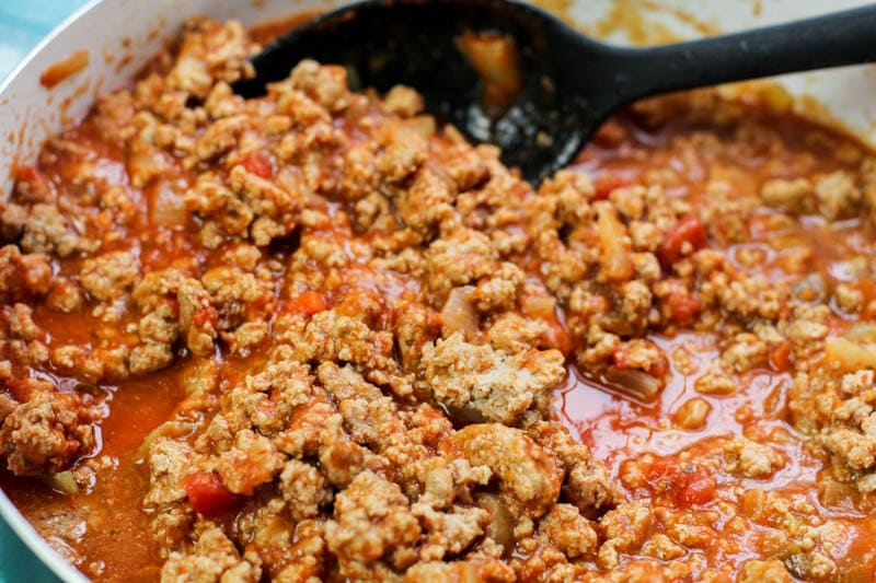 Puerto Rican lasagna meat sauce in the pan
