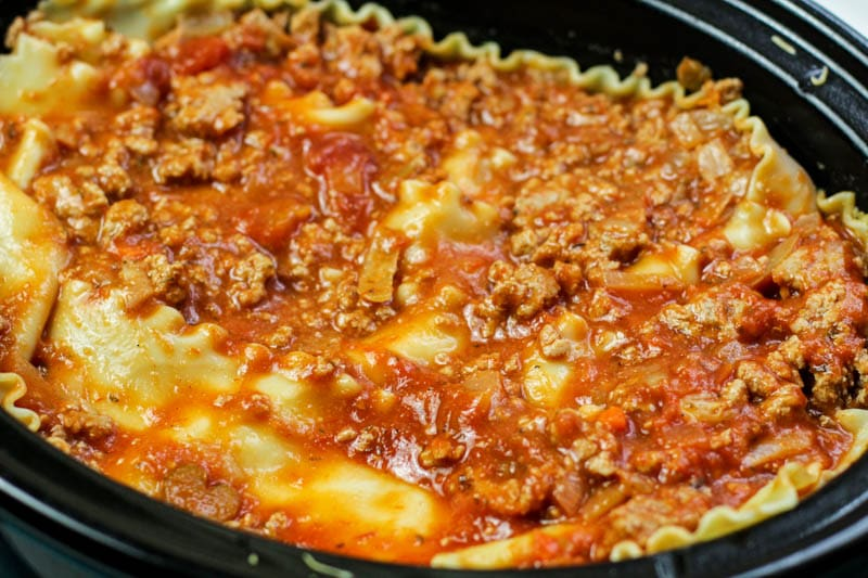 lasagna noodles and spaghetti sauce in slow cooker