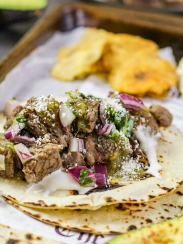 barbacoa taco on parchment paper