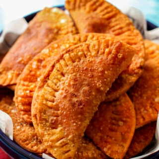 a pile of empanadas in a big bowl