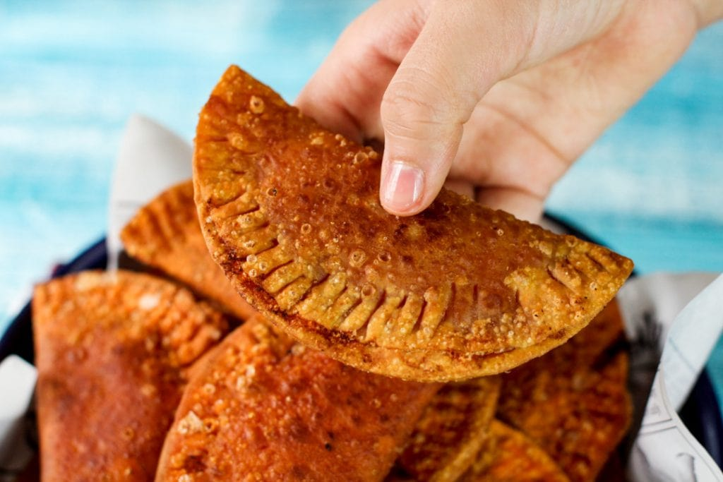 Empanada being held in a hand