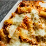 baked ziti in a white casserole pan