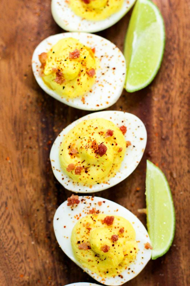 deviled eggs on a wooden serving board