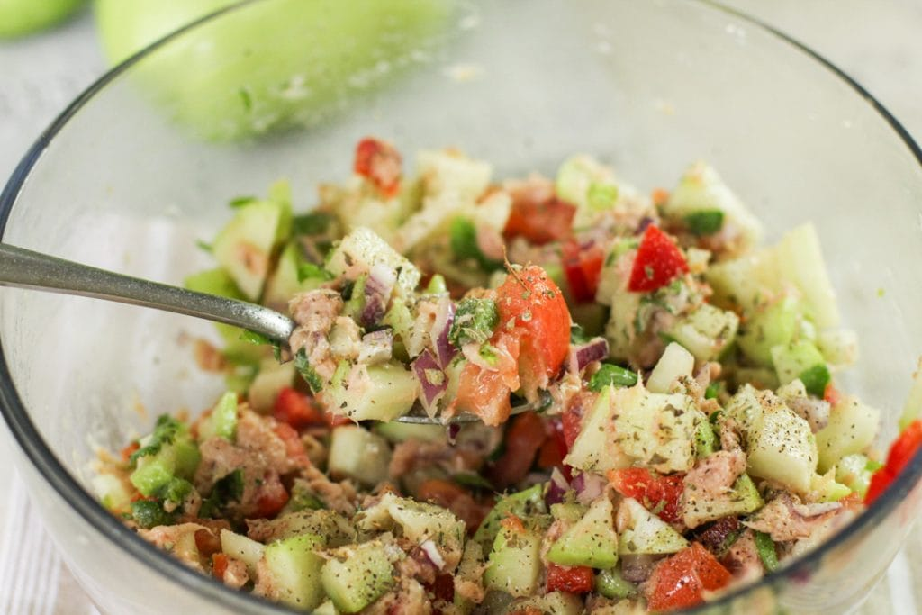 chayote tuna salad in a bowl with a spoon