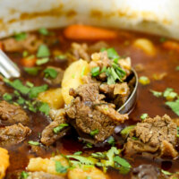 Beef stew and potatoes in a pot