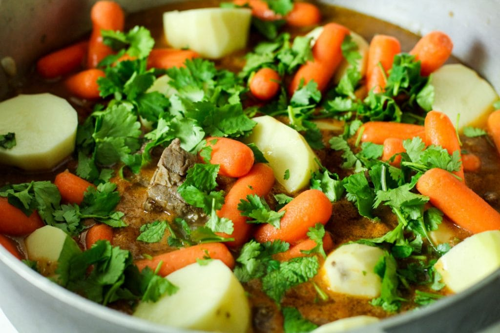 carne con papa and cilantro in a pot