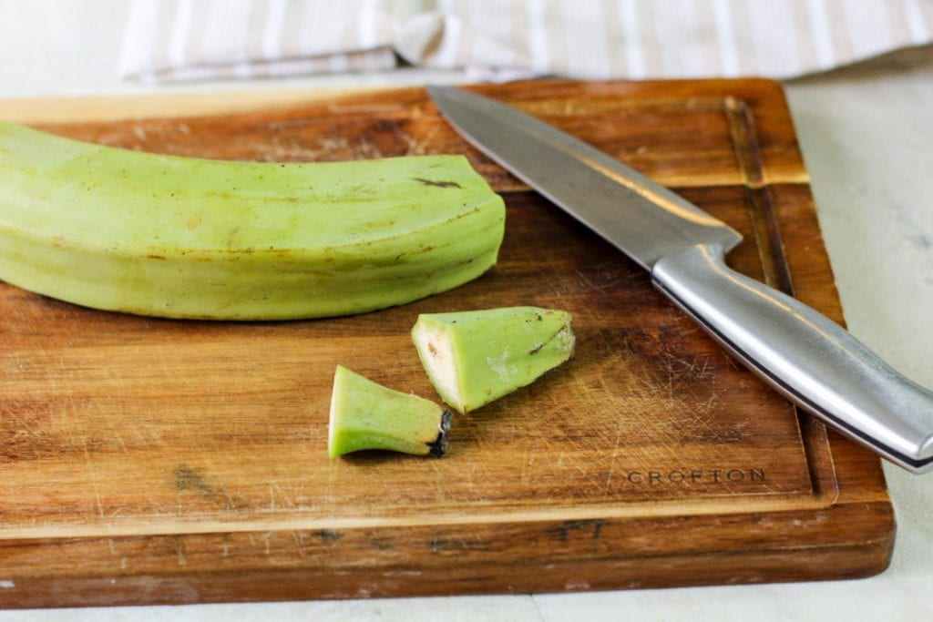 green plantain on a wooden cutting board
