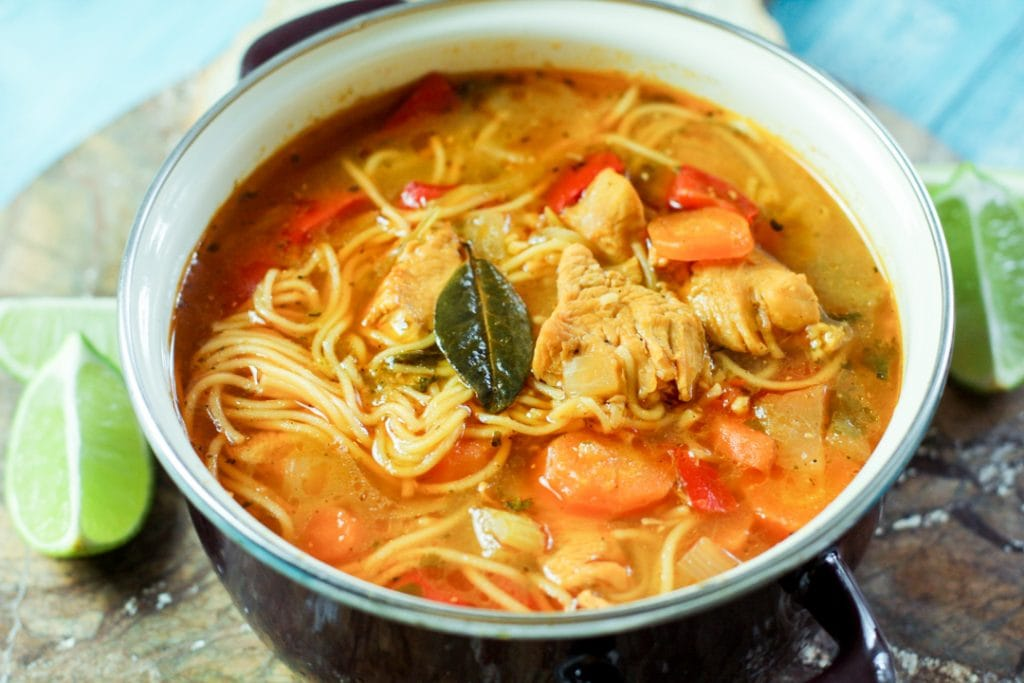 chicken noodle soup with vegetables in a pot