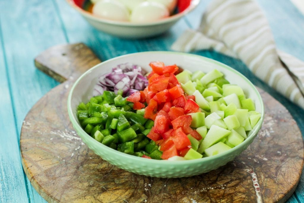 cut vegetables in a green bowl