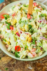 chayote egg salad in a white bowl