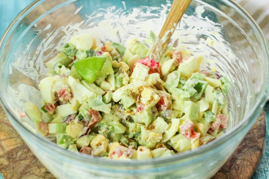 chayote egg salad in a glass bowl