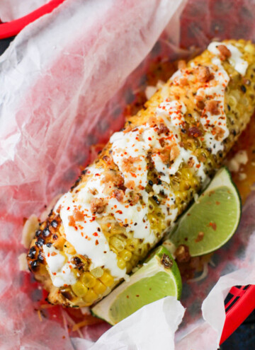 corn with sour cream and lime wedges