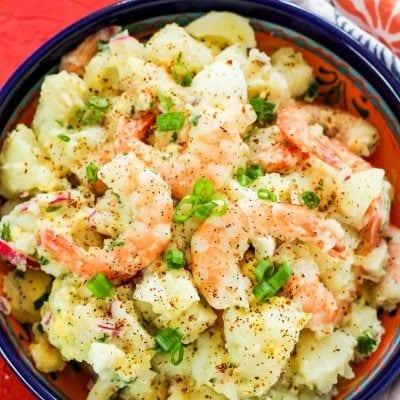 Shrimp potato salad in blue bowl