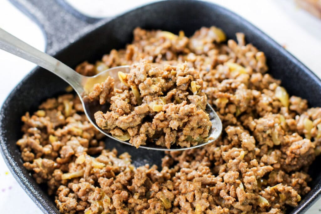 picadillo mixture with a metal spoon