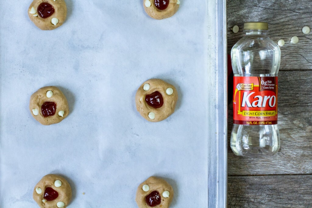 raw guava cookie dough balls on parchment paper lined pan