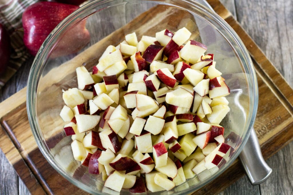 chopped apples in a glass bowl