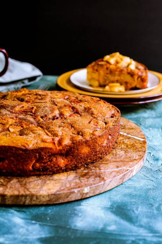 Pumpkin apple cake on a brown platter