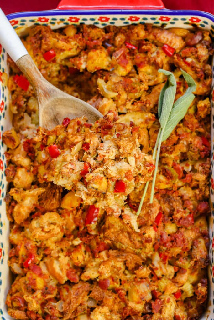 chorizo stuffing with sage and a wooden spoon