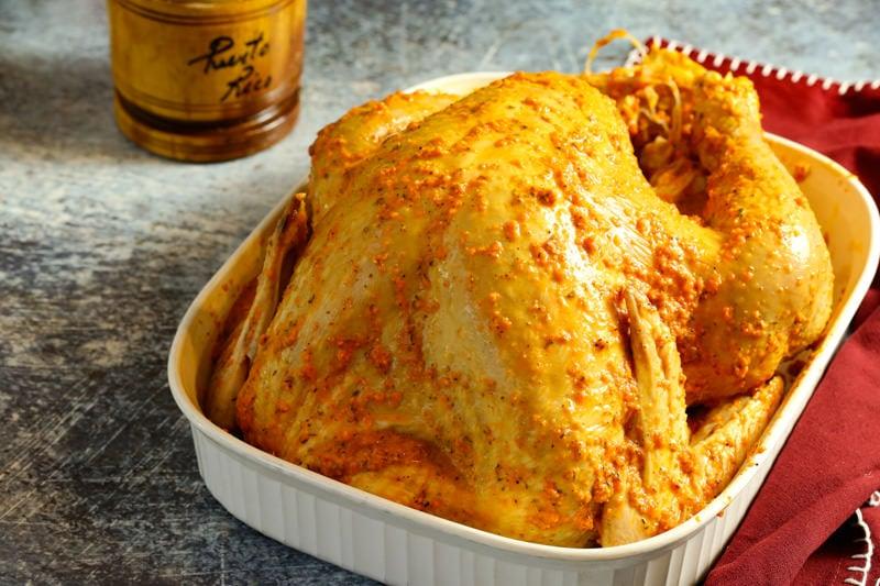 raw turkey in a white casserole dish
