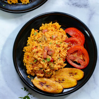 overhead shot of spanish rice on a black plate