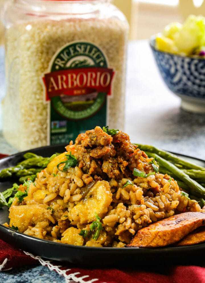 risotto with chorizo and asparagus on a black plate