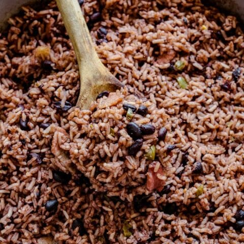 Cuban black beans and rice with a wooden spoon
