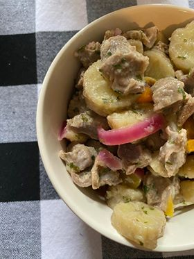 gizzards and green bananas in a white bowl